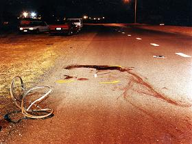 bicycle wheel moved, junk from another damaged vehicle on road