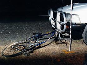 bicycle dragged out from underneath vehicle