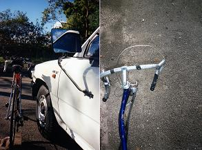 bicycle's right handlebar hooked up by ute's left edge of bullbar