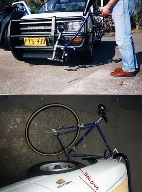 front portion of bicycle dragged under left front wheel of ute